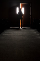 A woman opening a door