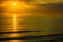 golden rays of sunlight over the ocean