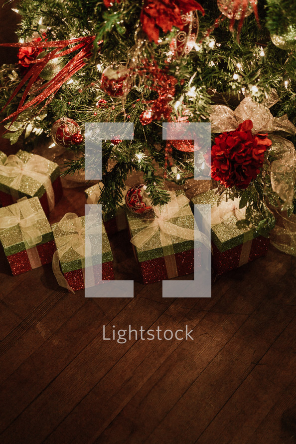 Christmas gifts under a Christmas tree