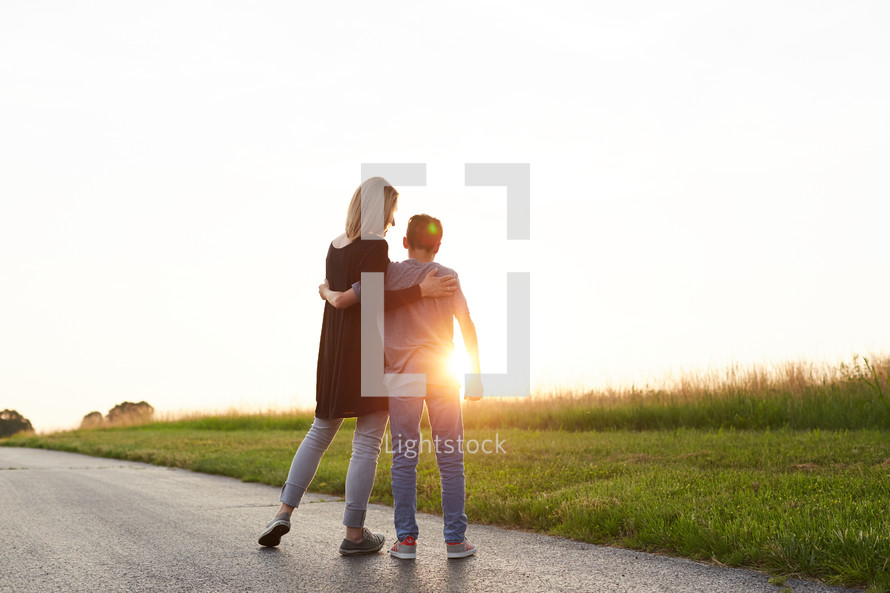 a mother and son hugging outdoors