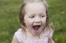 toddler girl outdoors yelling