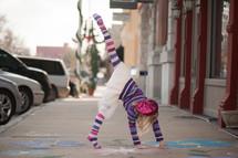 a girl child doing cartwheel