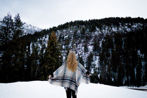 a woman standing outdoors in snow