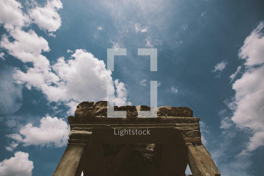 columns in ruins and clouds in a blue sky