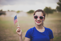 woman wearing stars and stripes sunglasses and a temporary tattoo