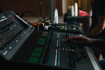 man behind a soundboard