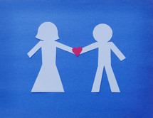 man and woman paper dolls with heart