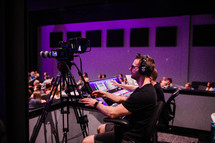 sound productions crew behind a soundboard