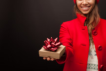 a woman giving a wrapped present
