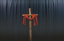 red shroud over a wooden cross