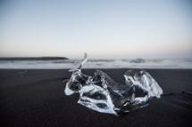ice on a black sand beach
