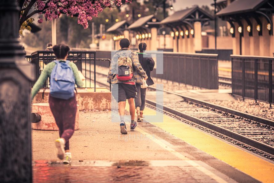Children running to catch a train.