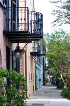 a balcony over a sidewalk