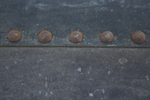 old rusty metal buttons on a trunk
