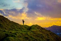 a man praying on a mountainside