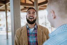 two men in conversation