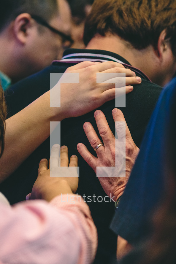 lying on of hands during a worship service