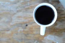 a coffee mug on a wood table