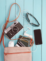 camera, purse, sunglasses, shades, passport, travel, iPhone, cellphone, earbuds, credit cards, bag