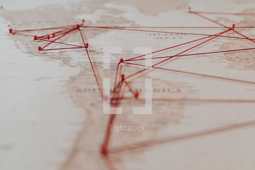 push-pins and string on a map