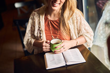women reading and discussing scripture over coffee