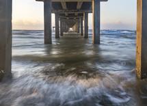 ocean under a pier