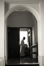 Priest in the sacristy.