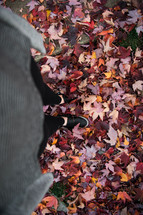 woman standing in fall leaves