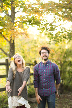 couple standing together laughing outdoors