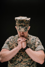 marine with praying hands