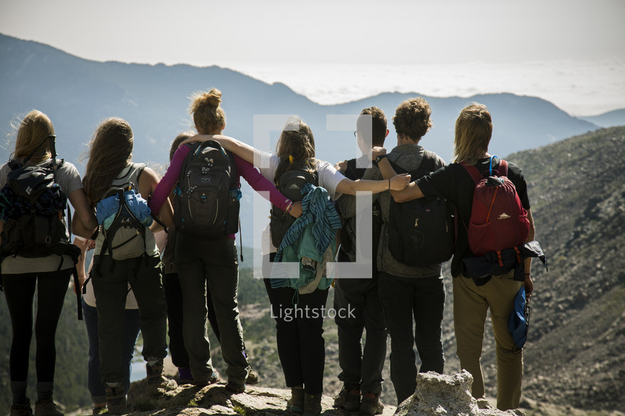 a group hiking on a mountain
