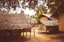 thatched and straw roofed huts in a village