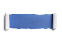 Blue beneath torn white paper.