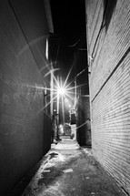 street light shining over a dark alley