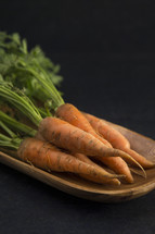 carrots in a wooden bowl