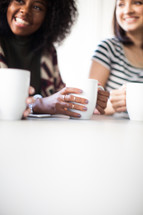 woman's group talking and drinking coffee