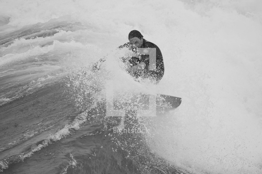 a man surfing on a wave