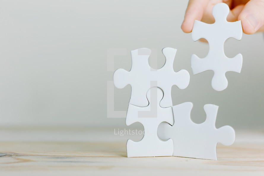 putting together puzzle pieces