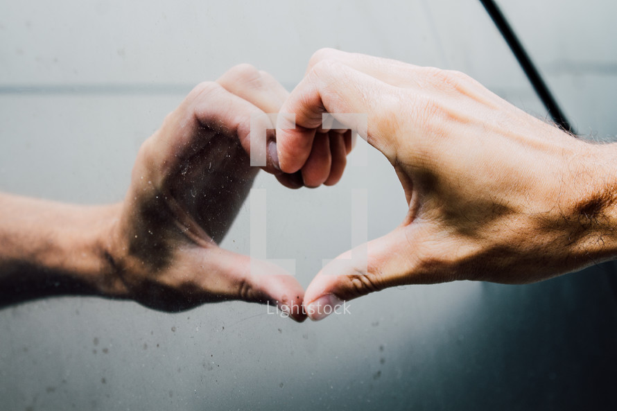 hand and reflection making a heart shape