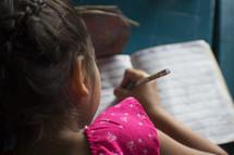 a little girl doing homework