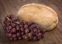 Grapes and Bread on a Table