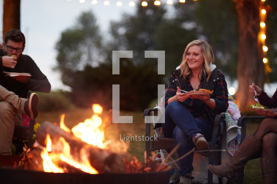 eating around a campfire
