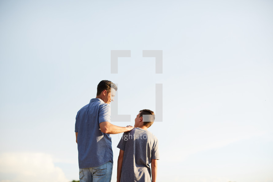 8854fa352 A father and son standing together outdoors — Photo — Lightstock