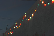 Christmas lights on the side of a wall