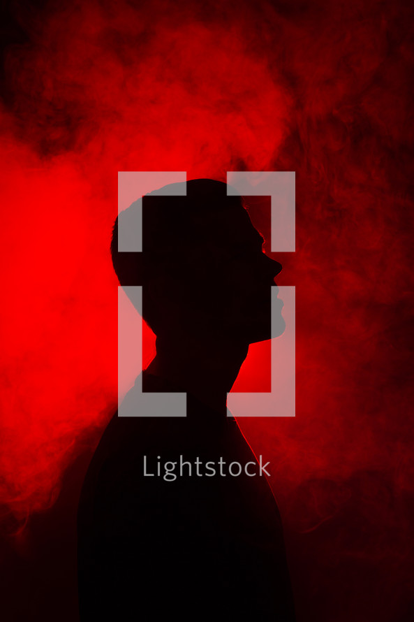 silhouette of a man with red backlight