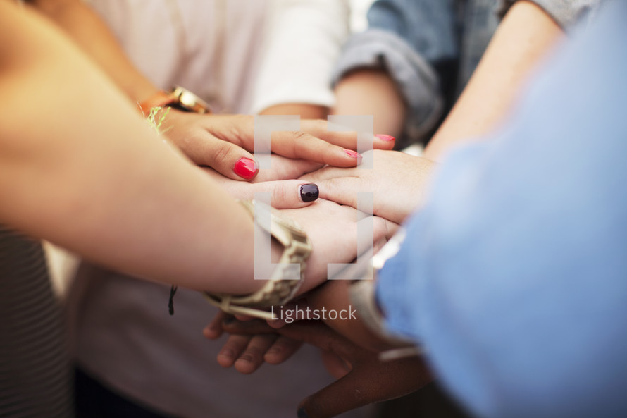 all hands in, women's group prayer