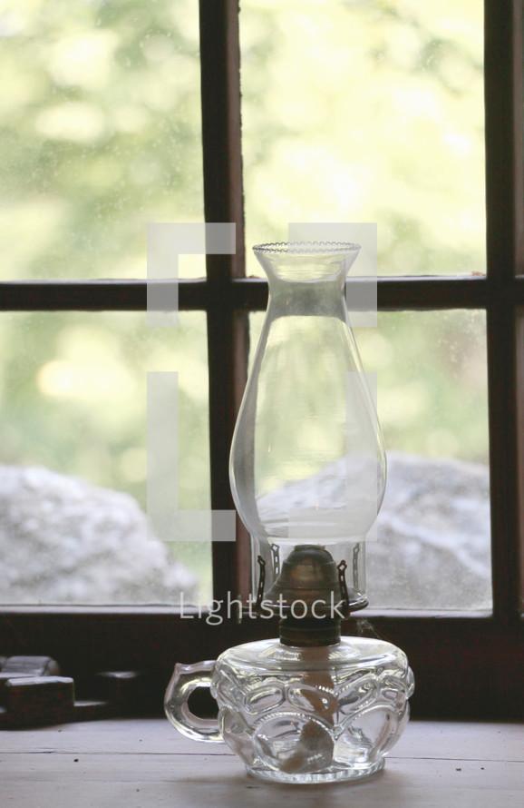 oil lamp in a window