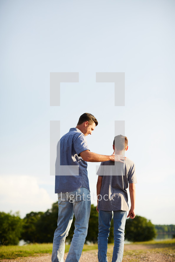 a father and son standing together outdoors