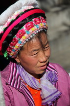 woman in a traditional hat