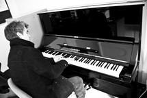man playing a piano